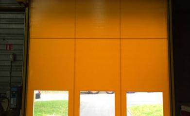 Pose d'une porte rapide en doublure d'une porte sectionnelle